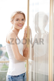 happy teenage girl at the window