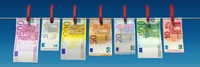 Freshly washed Euro banknotes are hanging on a clothesline