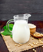 Milk soy in jug with flour on board