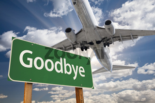 Goodbye Green Road Sign and Airplane Above