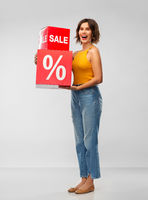 happy smiling young woman with sale signs