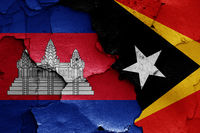 flags of Cambodia and East Timor painted on cracked wall