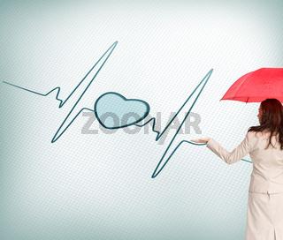 Composite image of businesswoman holding umbrella