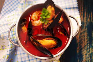 Bowl with seafood soup in cafe