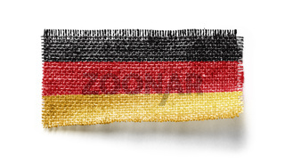 Germany flag on a piece of cloth on a white background