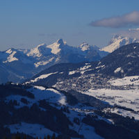 Village Leysin and snow covered mountain range.