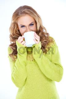 Woman Wearing Green Sweater Drinking from Mug