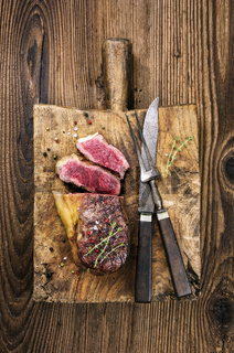 steak on the old wooden board