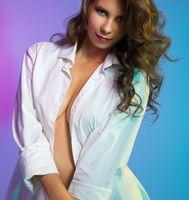 Flirty girl posing in blouse over her naked body