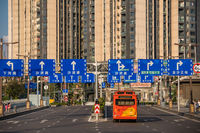 Highway leading to high residential blocks in Chongqing city suburb