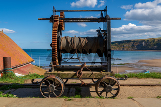An old rope winch on the coast
