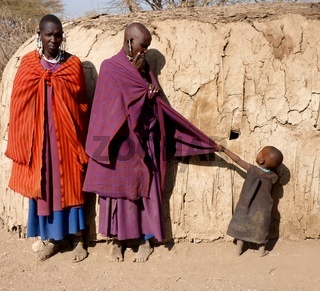 Masai mum and dad with impatient toddler