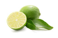 Limes with leaves isolated against white
