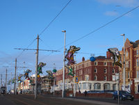 hotels on queens promenade in Blackpool near the cliffs with passing traffic