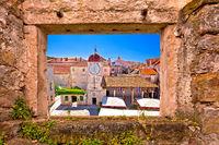 UNESCO Town of Trogir main square viewthrough stone window