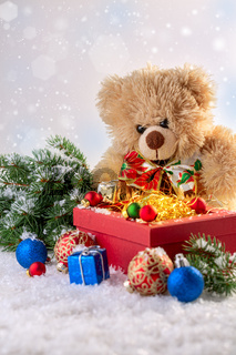 Merry Christmas gift box and soft toy bear greeting card.