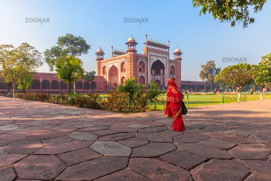 Taj Mahal East Gate and an Indian woman, India, Agra