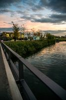 sunset at neckar side river wooden bridge