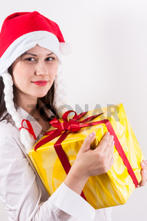 Young woman with christmas present on white background