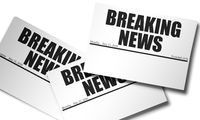 Newspaper with breaking news headline