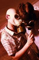 Men in a gas mask on night street