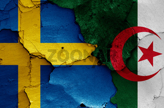 flags of Sweden and Algeria painted on cracked wall