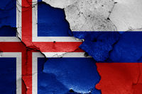 flags of Iceland and Russia painted on cracked wall