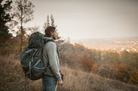 Young Backpacker Hiking In Autumn Nature