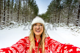 Happy woman enjoying outdoors in the snow