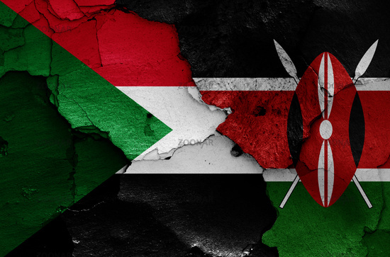 flags of Sudan and Kenya painted on cracked wall