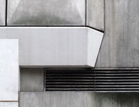 close up details of geometric grey textured concrete panels on an old brutalist building