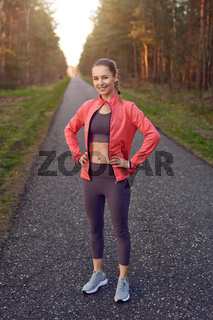 Sporty young girl with hands on hips