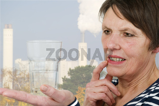 thoughtful look at a glass of water industry
