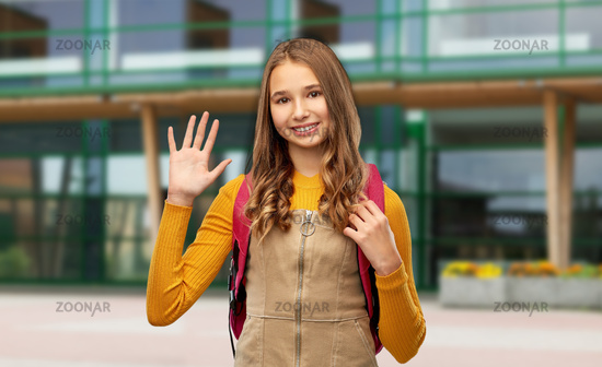 teenage student girl with backpack over school