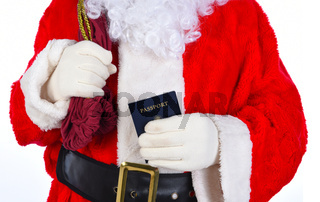 Closeup of Santa Claus with his passport in one hand and his bag over his sholulder.