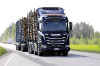Scania R650 XT Logging Truck Hauls Timber