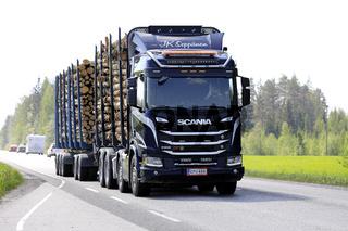 Scania R650 XT Logging Truck Hauls Timber