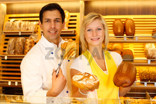 Baker and shopkeeper present pastry