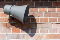 Megaphone in front of an old brick wall