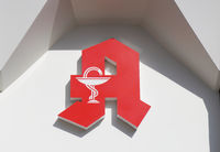 German Apotheke - which translates as pharmacy or drugstore - with red A logo sign in Hannover, Germany on March 16, 2020