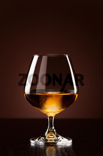 Alcohol with ice cubes in snifter