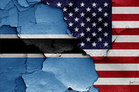 flags of Botswana and USA painted on cracked wall