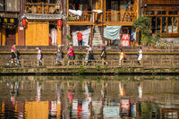 People walking in front of Fenghuang Old Town homes
