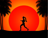 The silhouette of the running woman in the sunset.
