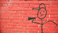 The figure of a drawn man holding a megaphone.