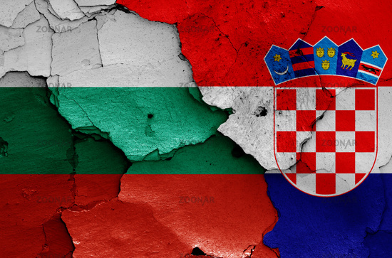 flags of Bulgaria and Croatia painted on cracked wall