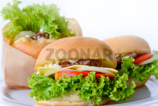 Group of three hamburger on a white background