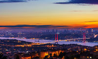 Sunset and illumination of the Bosphorus bridge and buildings of Istanbul, Turkey