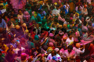 People celebrate the fertility of spring and enjoy the colorful Holi Festival in Benke Bieri Temple