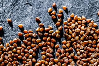 Buckwheat grain closeup, food texture and cook book background